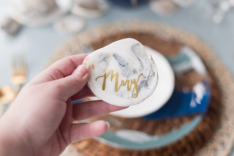 Oyster shell wedding place card with gold calligraphy using DecoArt glass paint marker