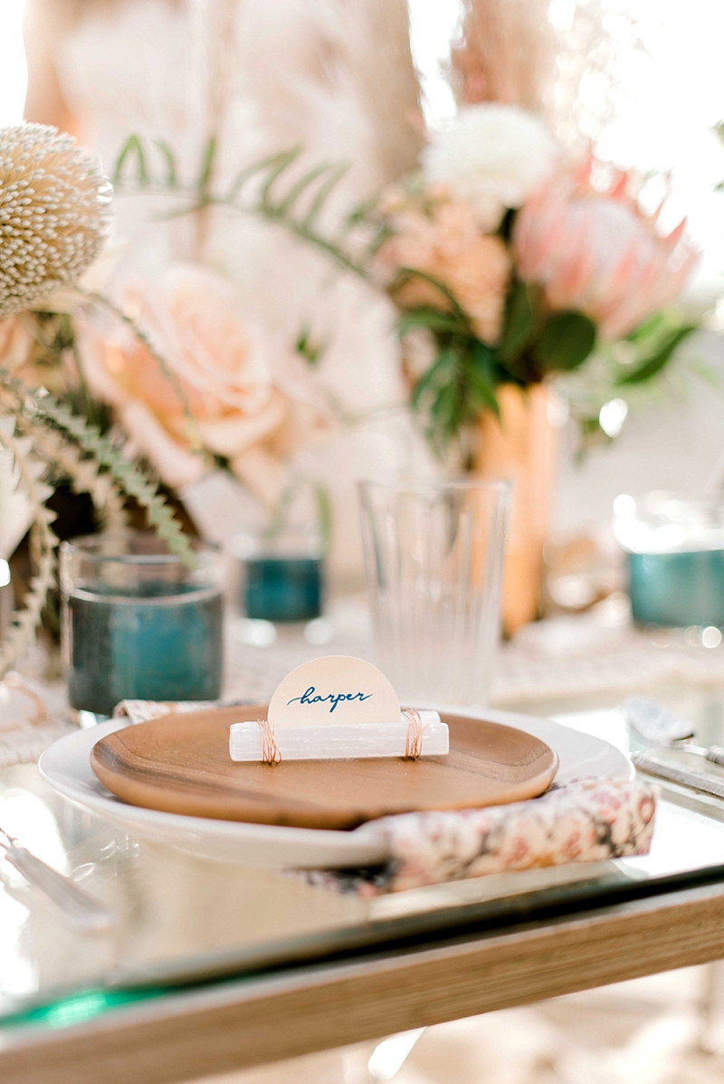 Unique modern wedding place cards made with selenite crystal sticks and Cricut writing pens for boho beach wedding