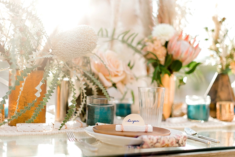 Wildly elegant boho wedding reception ideas with selenite crystal place cards and banksia textured flowers