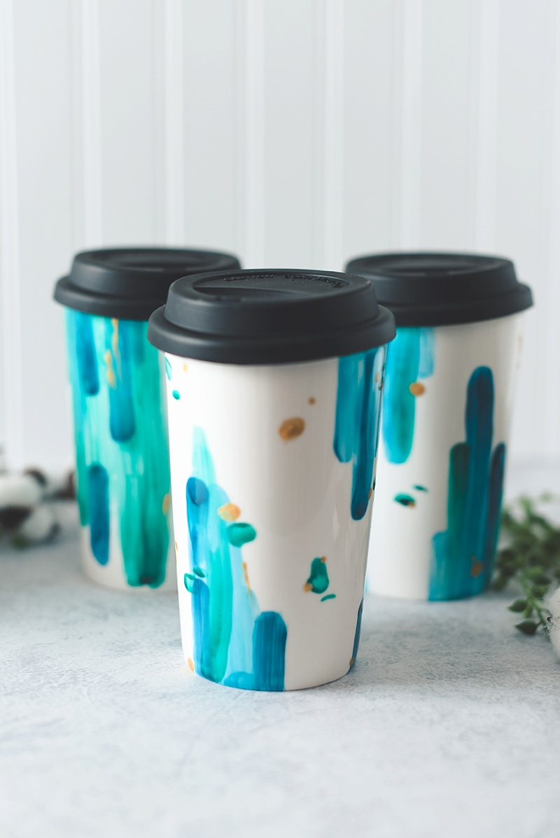 Beautiful DIY painted ceramic travel mugs for your wedding party using gold porcelain paint