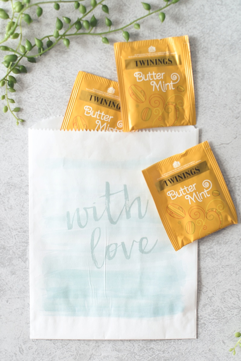 Adorable aqua watercolor inspired paper favor bags from Kate Aspen