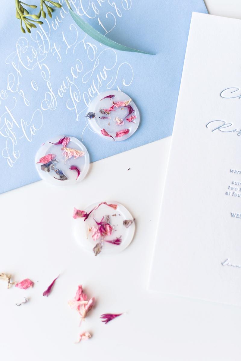 DIY vellum wax seals with dried flowers for a garden wedding