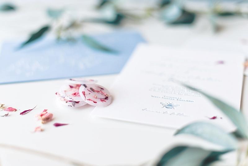 DIY vellum wax seals with dried florals for a letterpress wedding invitation