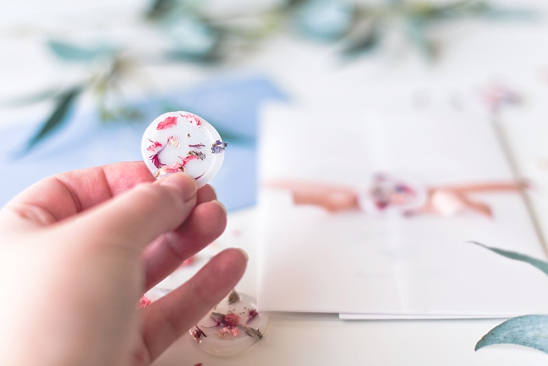 DIY vellum wax seals with dried flowers for a garden wedding invitation suite
