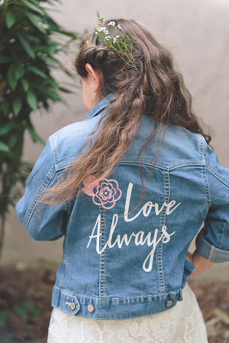 Adorable DIY denim wedding jacket for flower girl made with Cricut Explore Air 2 and patterned iron on material