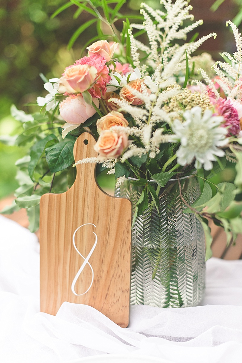 DIY wood table numbers made with serving boards and Cricut Explore Air 2 machine