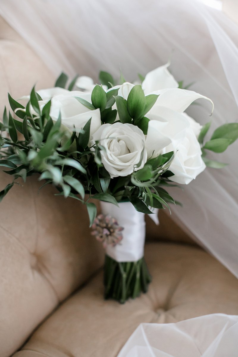 Classic and simple all white wedding bouquet for military bride with calla lilies and greenery