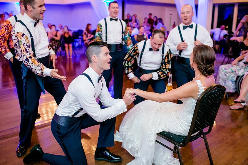 Funny groom and groomsmen singing to the bride at wedding reception at Fredericksburg Country Club in Virginia