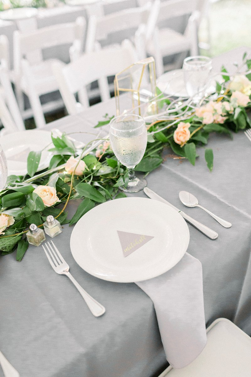 Gray and silver wedding reception tables with gold geometric vases and greenery garlands for rustic decor ideas