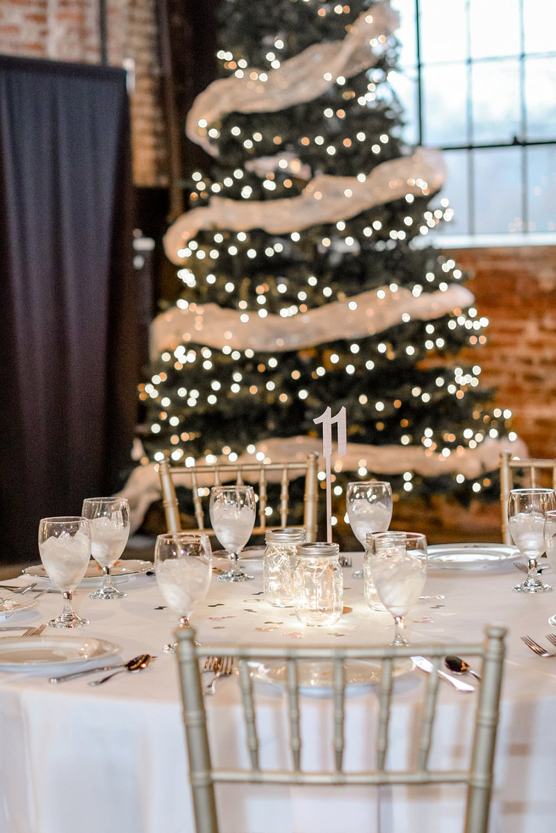 Simple Christmas wedding reception decoration ideas with table number and Christmas tree twinkle lights