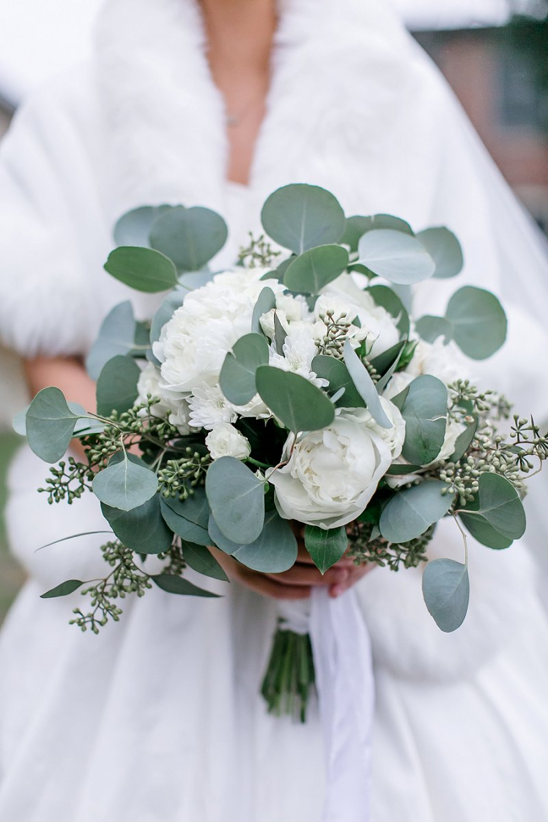 White and green bridal bouquet with peonies and eucalyptus for a classic winter wedding