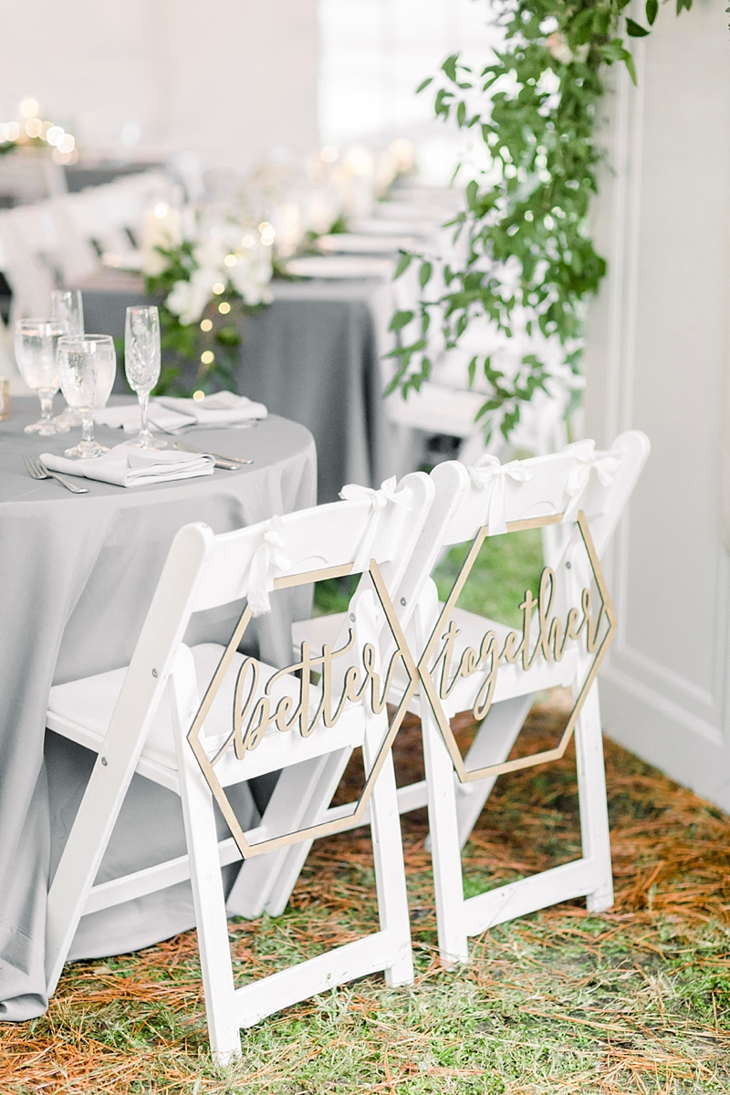 Modern geometric Better Together wedding chair signs for bride and groom at tented rustic wedding reception
