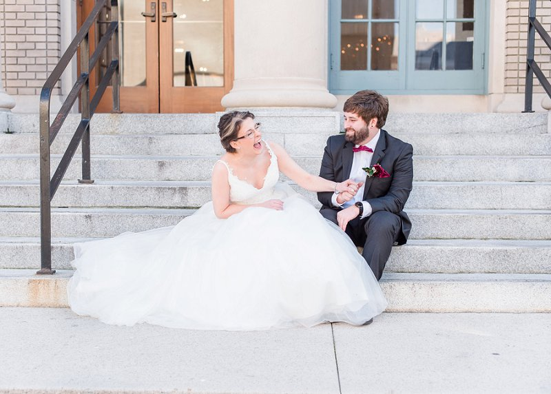 Laughing bride wearing glasses with her groom at The Historic Post Office in Hampton Virginia