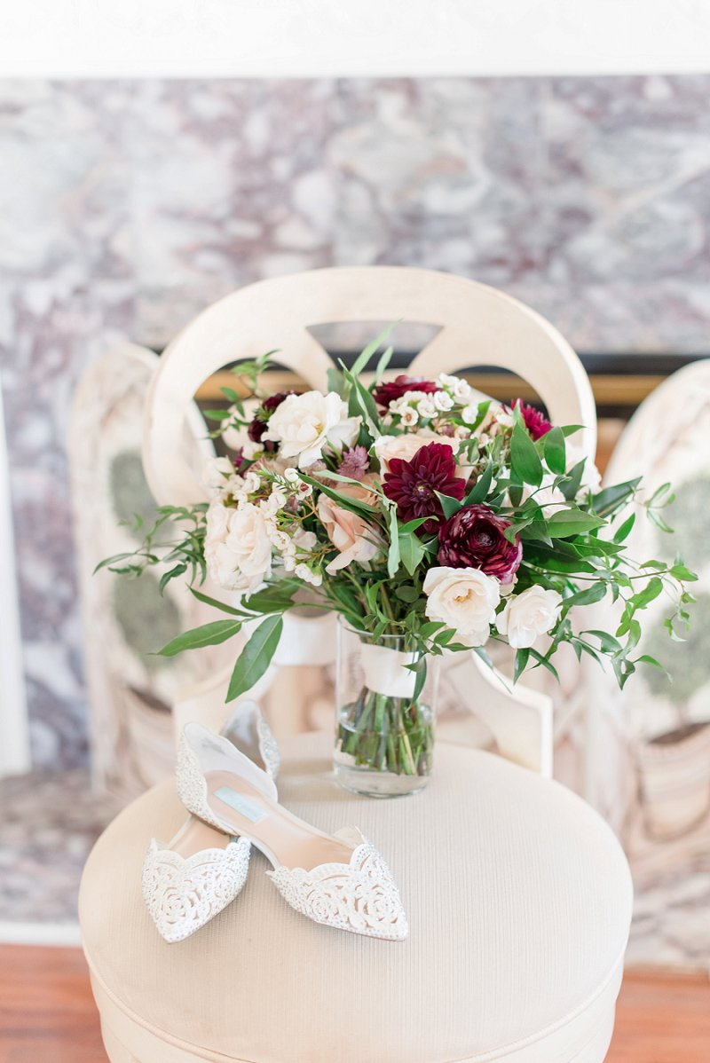 Burgundy red and white bridal bouquet with greenery for winter wedding flowers on Virginia Wedding Blog