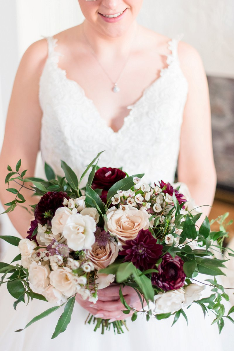 Burgundy red and white bridal bouquet with greenery for winter wedding flowers