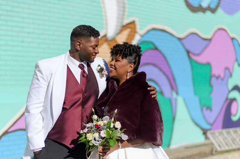 Beautiful black bride and groom for their winter wedding at Historic Post Office in Hampton Virginia