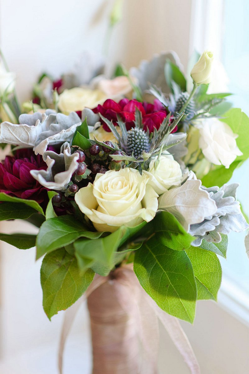 Winter bridal bouquet with blue thistle and dark magenta red dahlias for a chic wedding at the Historic Post Office in Hampton Virginia