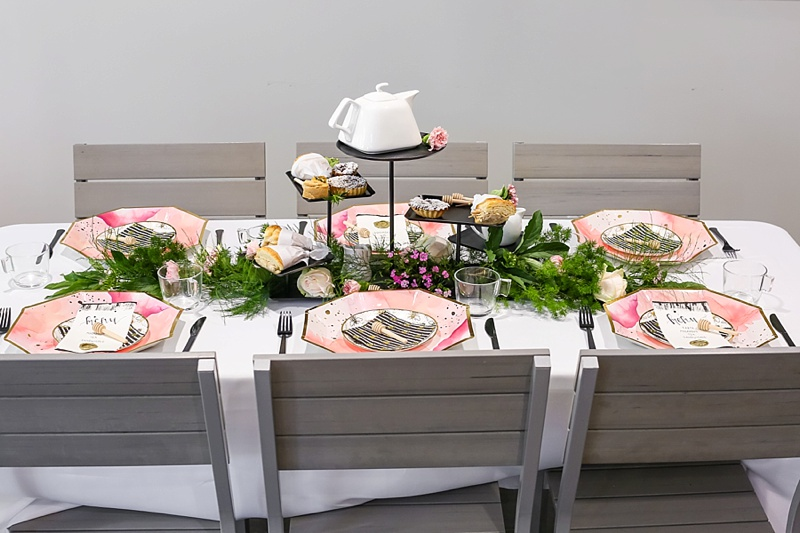 Chic bridal shower table ideas with stylish paper plates and tiered tea menu