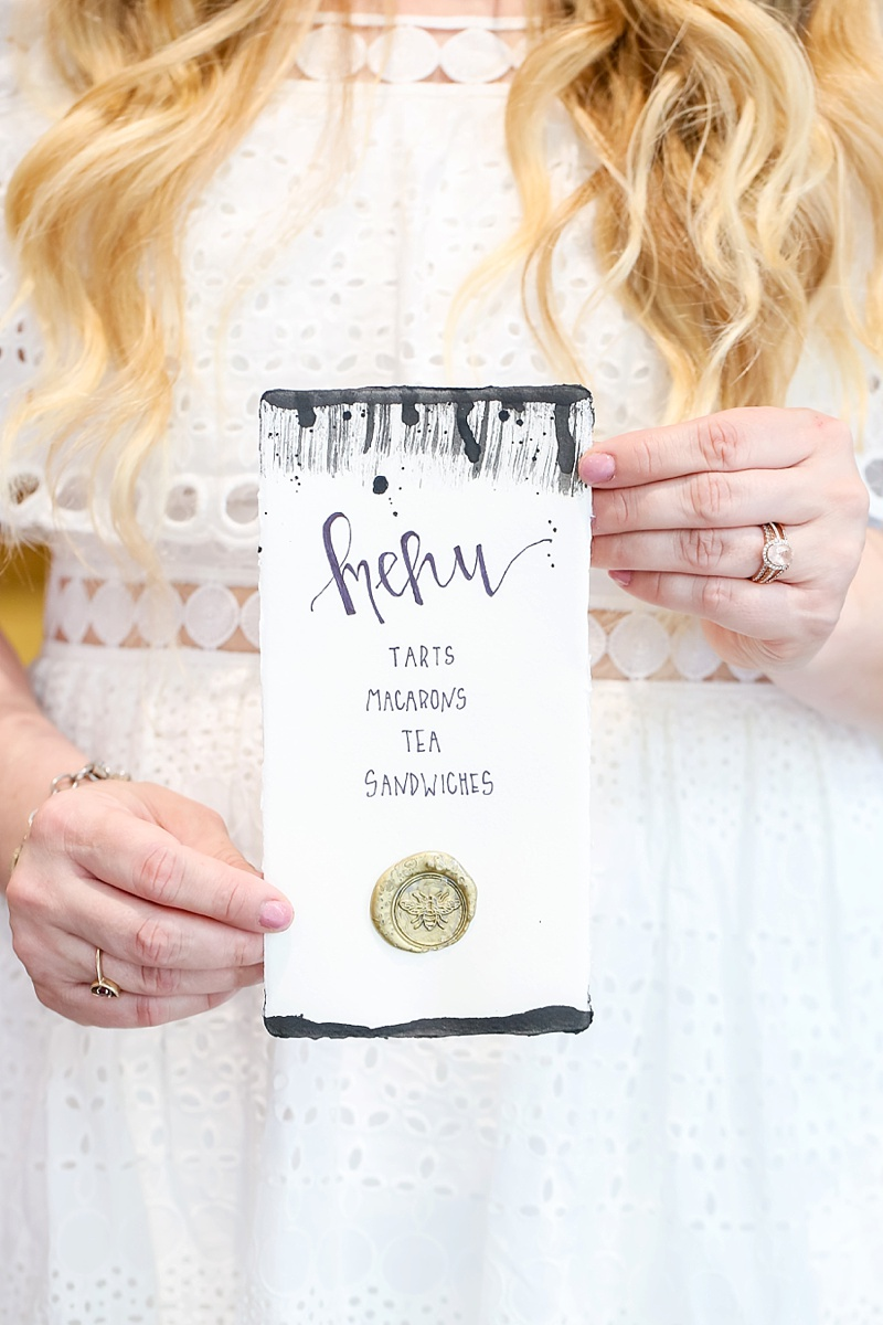 Handlettered and painted bridal shower menu with gold wax seal with a bee