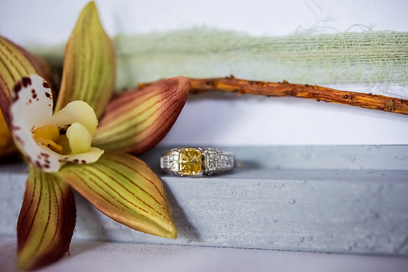 Gorgeous unique yellow diamond engagement ring with embedded diamonds in the band