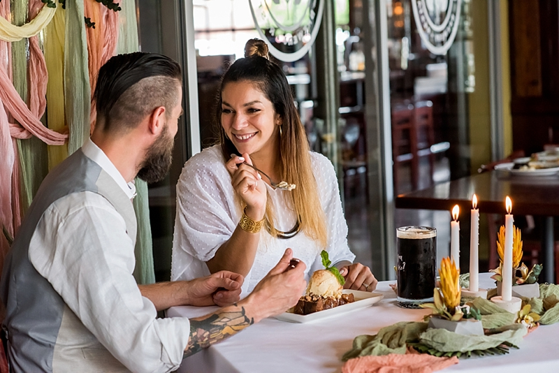 Fun and unique way to propose at Gordon Biersch Virginia Beach using a mug of beer and chic tropical decor