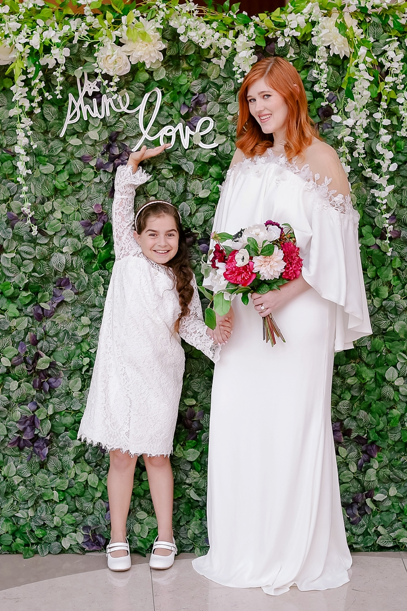Adorable short lace flower girl dress with bell sleeves