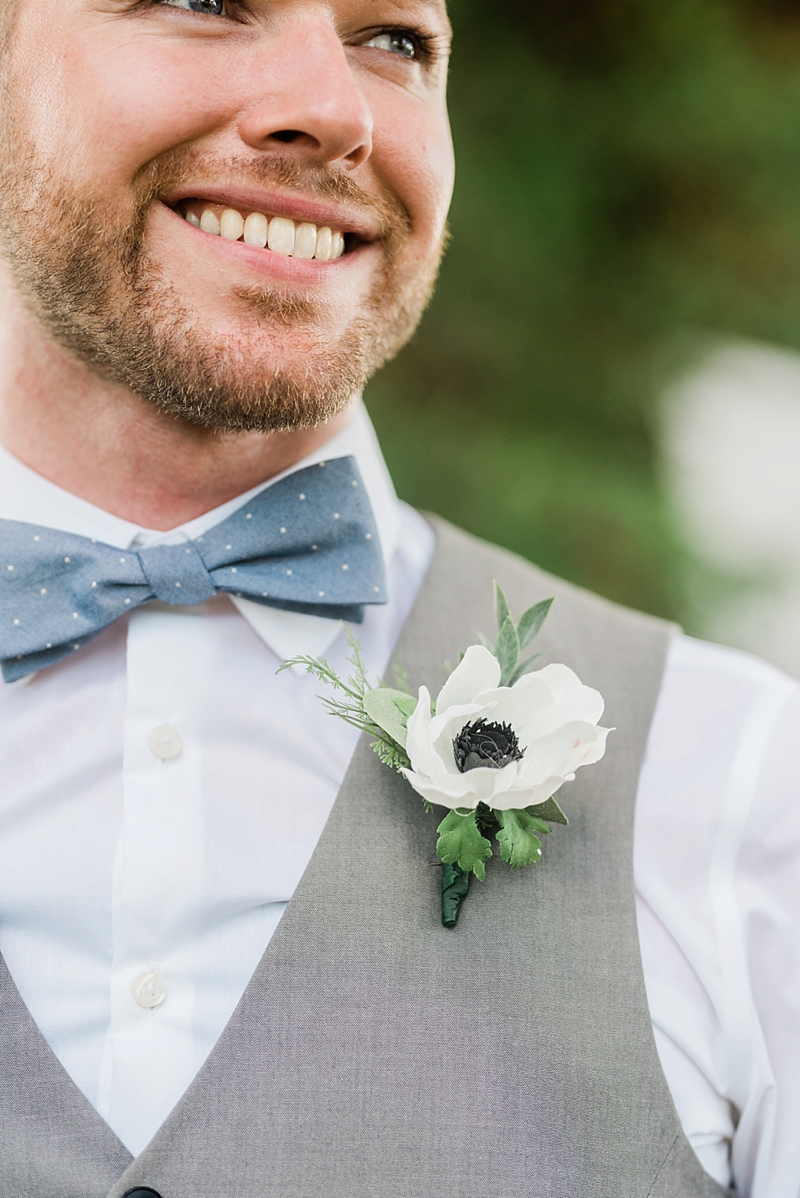 Simply classic white anemone floral boutonniere for micro wedding ideas