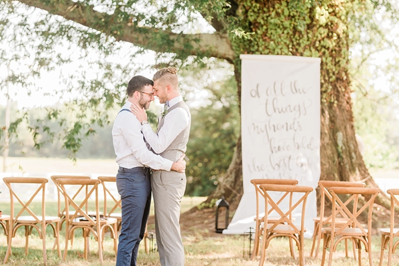 Beautiful intimate outdoor wedding ceremony with calligraphy banner for small micro wedding in Virginia on Virginia wedding blog