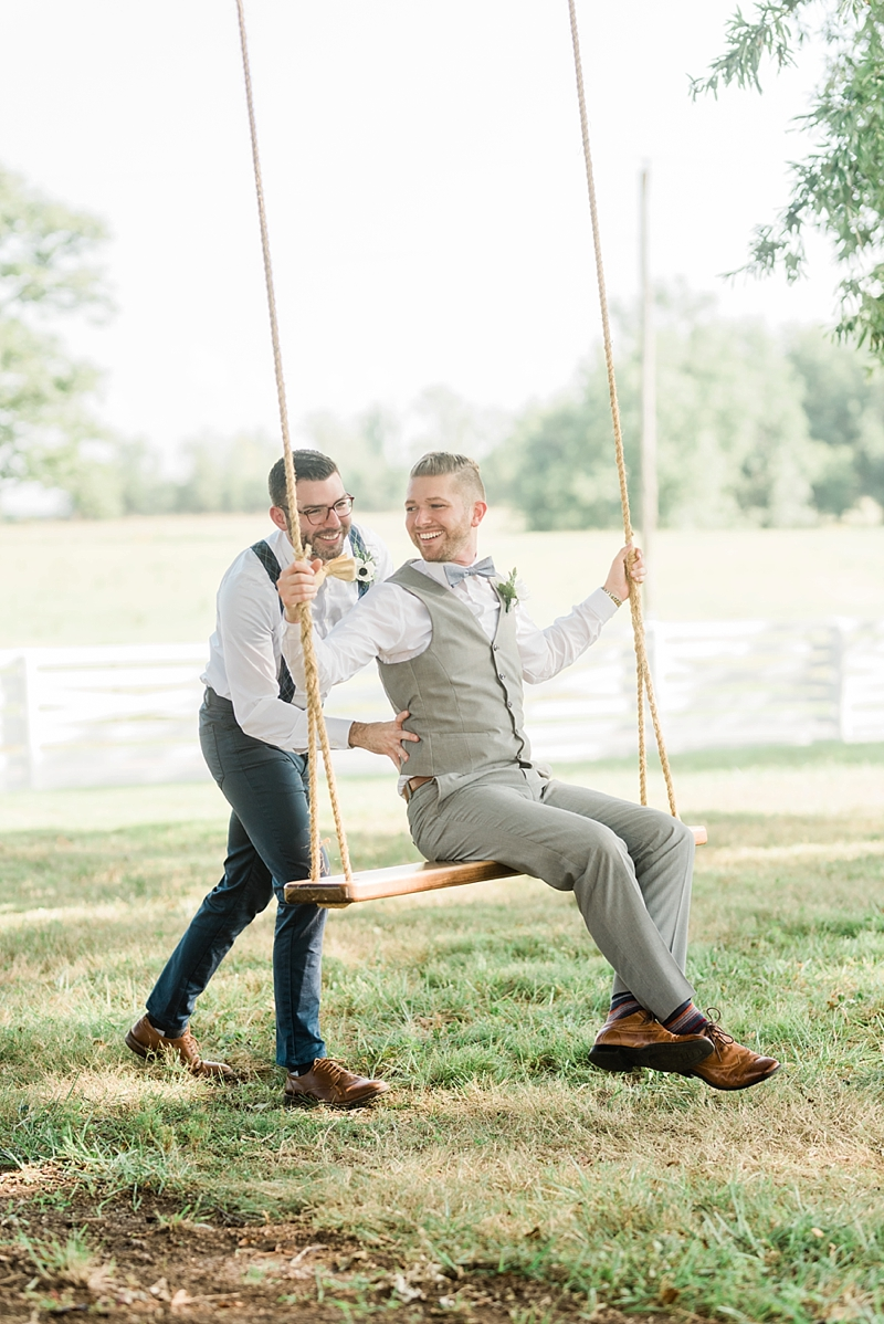 Dapper grooms sharing a moment on the swing for their micro wedding day on Virginia wedding blog