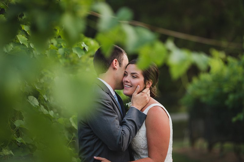 Sweet moment between bride and groom in the vineyard at New Kent Winery in Virginia