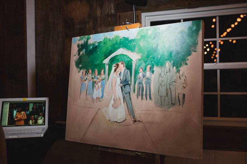 Beautiful live painting at a rustic Virginia winery wedding done by an artist on site