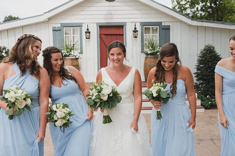 Beautiful rustic wedding with bridesmaids in pale sage green dresses at New Kent Winery in Virginia