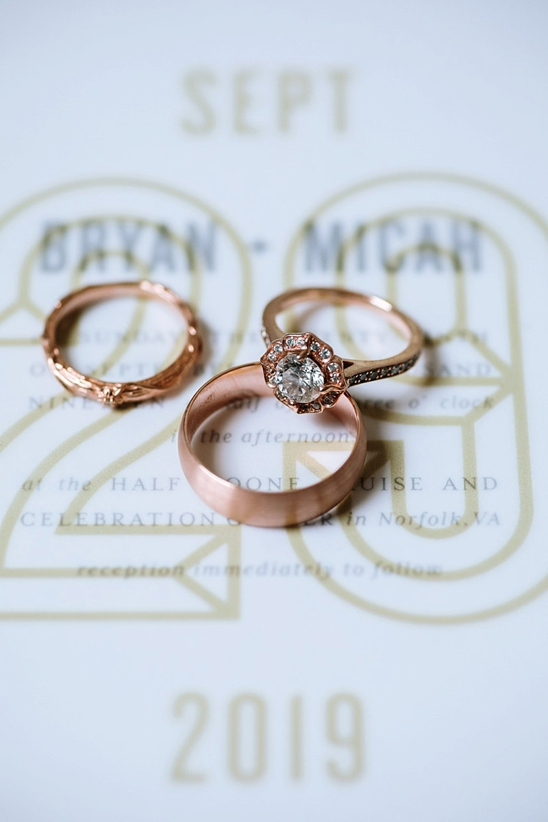 Gorgeous rose gold wedding rings with a floral shaped diamond and matching wedding bands