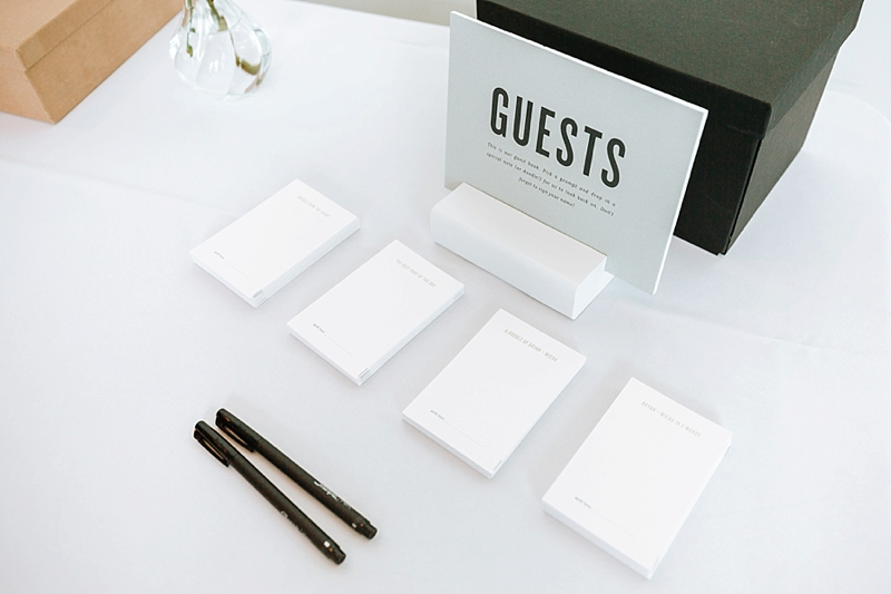Unique wedding guestbook idea where guests follow a writing prompt for the happy couple