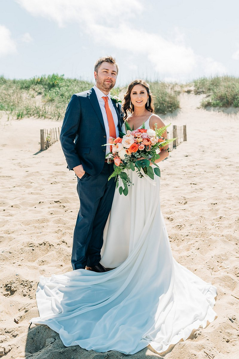 Beach bride and groom for an orange modern wedding in the Outer Banks