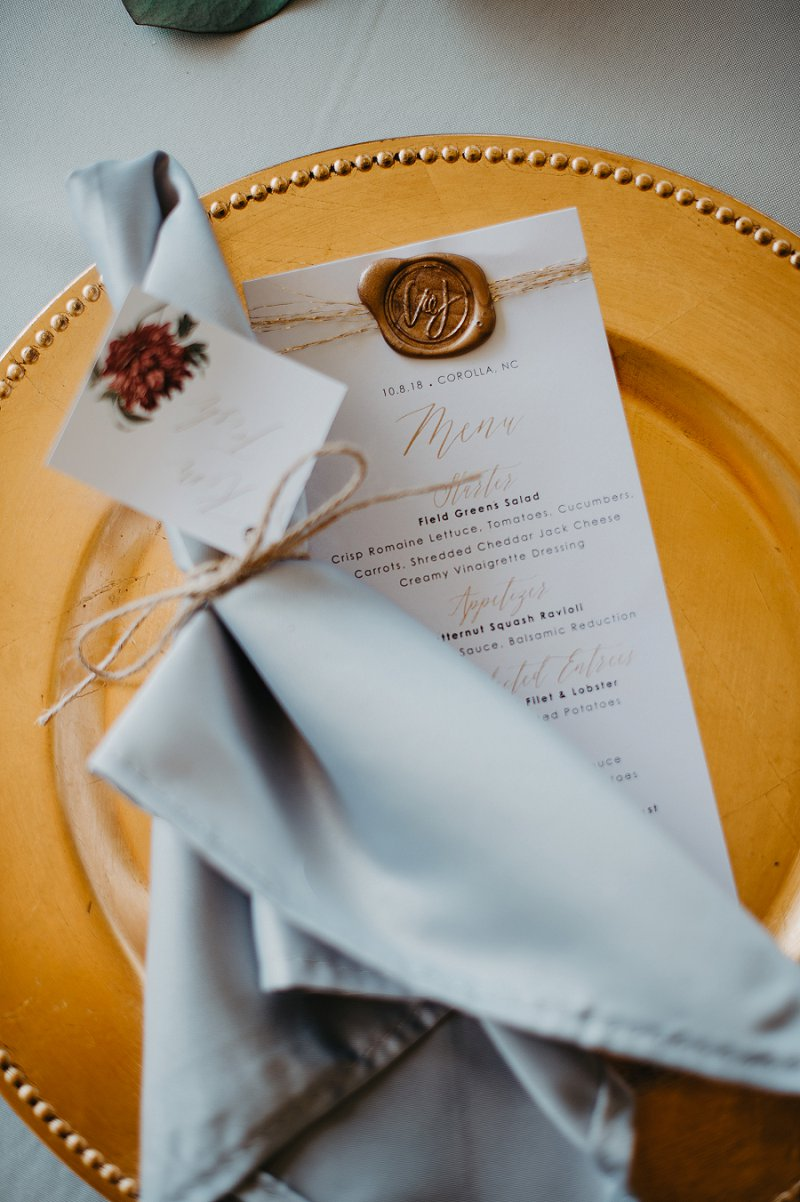 Beautiful boho fall wedding menu card with gold wax seal and metallic twine
