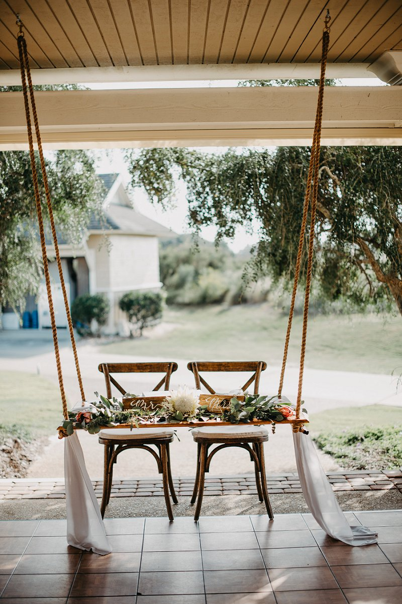 Beautiful suspended wedding sweetheart table for outdoor reception