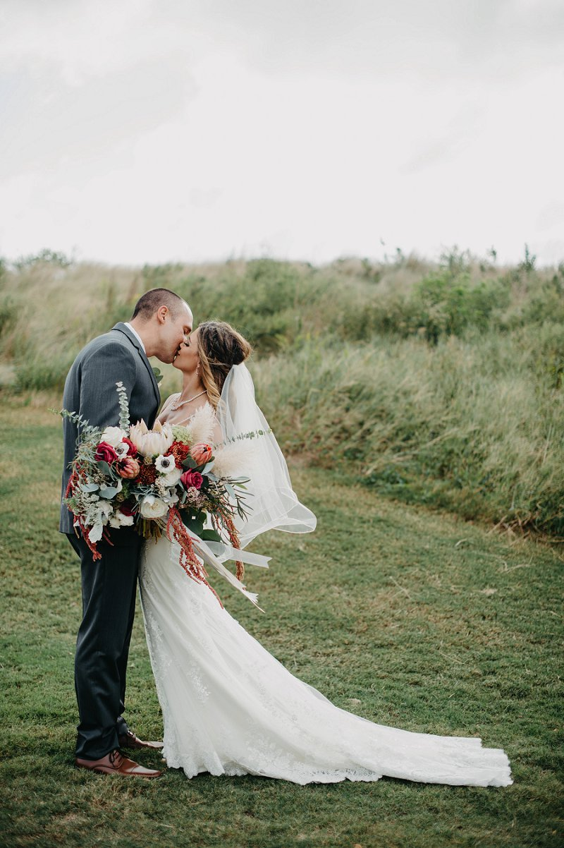 Boho destination wedding with bride and groom at the Currituck Club in the Outer Banks