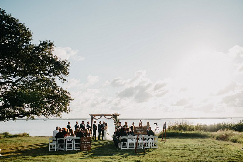 Waterside wedding ceremony at the Currituck Club for a beautiful Outer Banks wedding