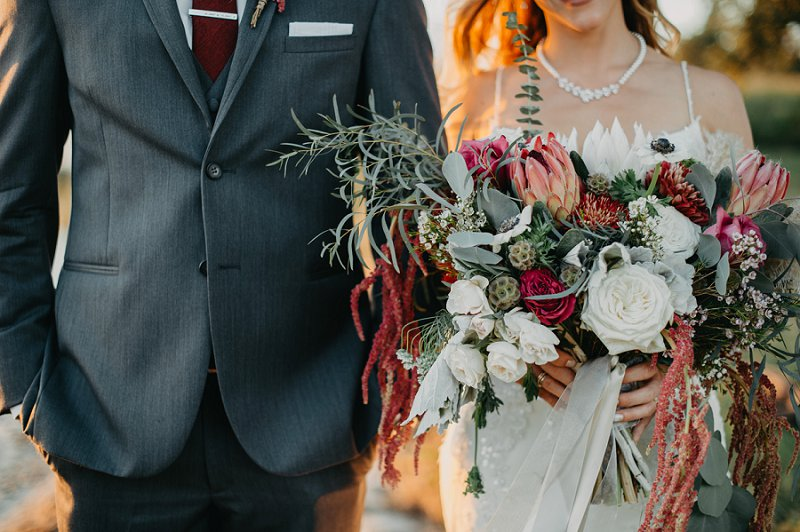 Large and free flowing wedding bouquet with pampas grass and protea in muted colors
