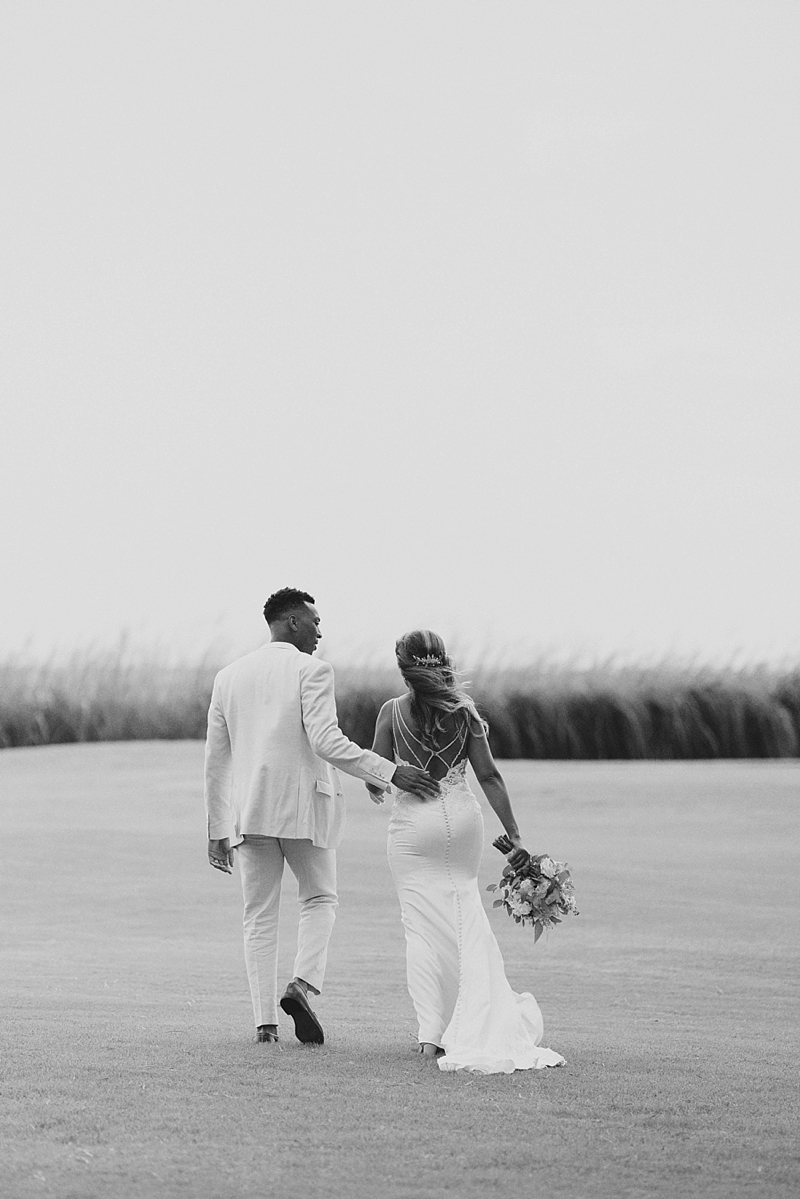 Timeless black and white photo of bride and groom on their wedding day in Outer Banks North Carolina
