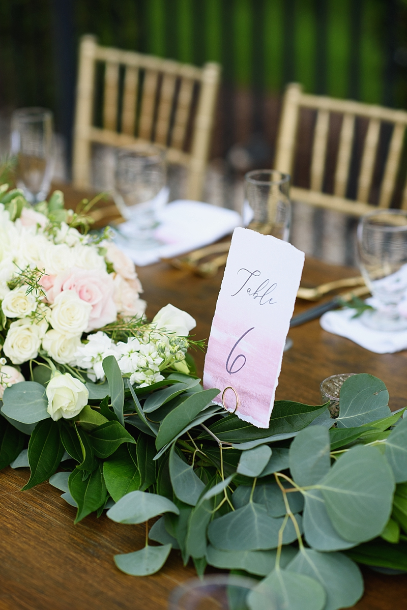 Pink and magenta watercolor ombre wedding table number with deckled edges for outdoor beach house wedding reception
