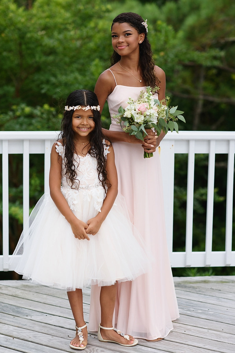 Adorable flower girls in pink and white dresses for COVID affected beach house wedding in the Outer Banks