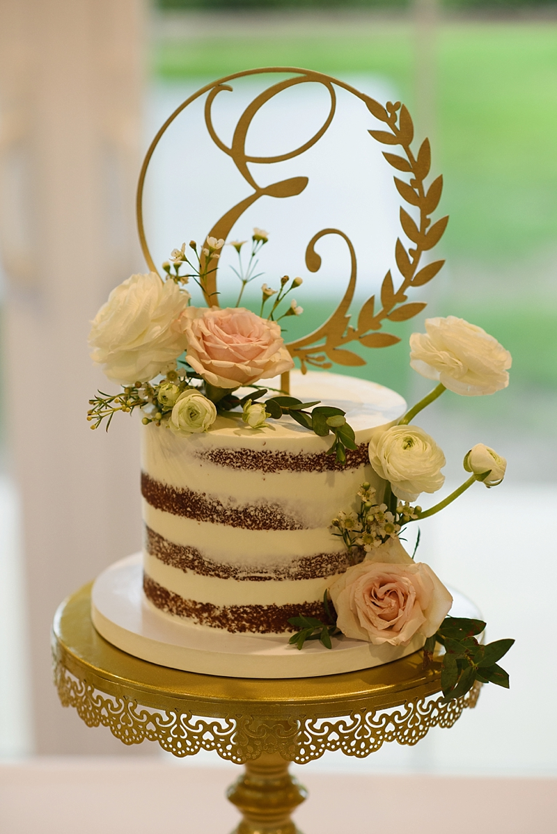 Petite semi naked wedding cake with wood monogram cake topper and flowers