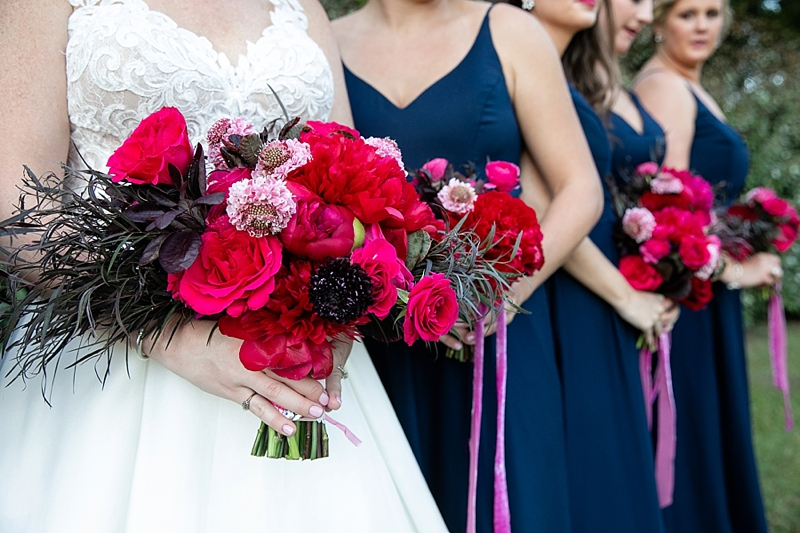 Bright pink wedding bouquets with coastal textures for navy blue wedding ideas