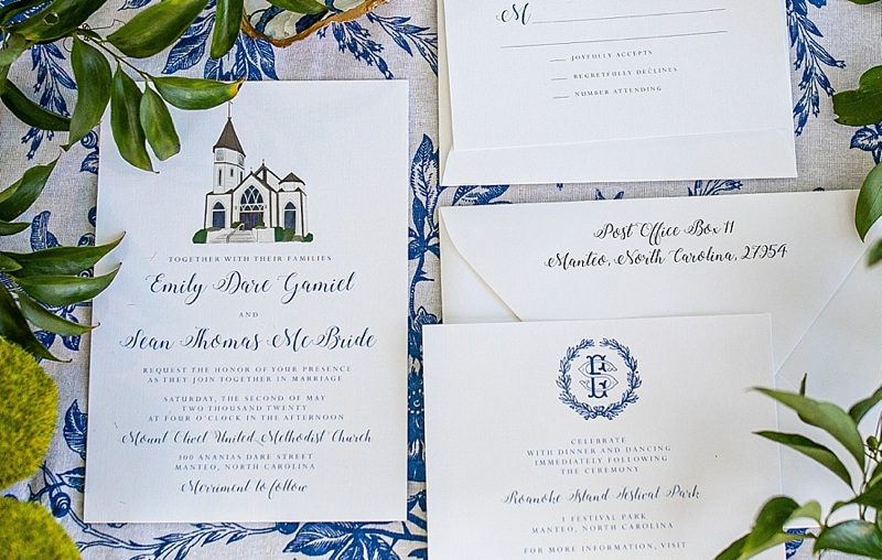 Traditional navy blue wedding stationery with illustration of church for rescheduled wedding day