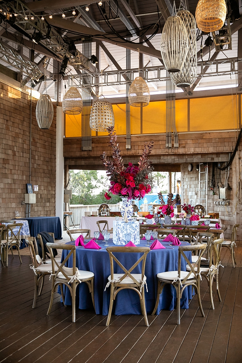 Navy blue and magenta pink Outer Banks wedding with ginger jar wedding ideas and boho lanterns