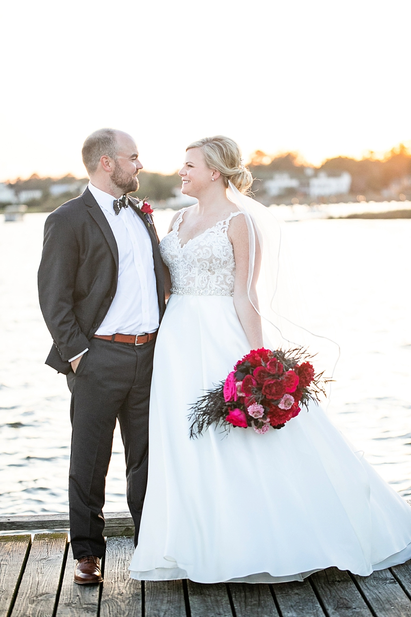 Lovely moment between bride and groom on the dock at Roanoke Island Festival Park in Manteo Outer Banks for their coastal wedding
