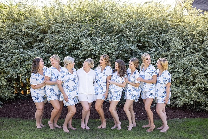Bride and bridesmaids wearing blue toile pajamas for getting ready on the wedding day