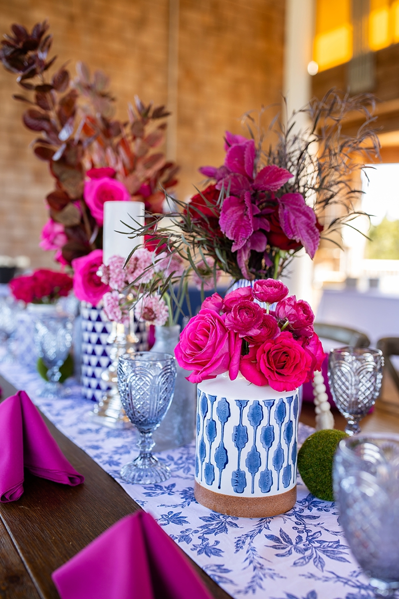 Blue and white ginger jar wedding centerpieces with bold pink flowers for unique coastal wedding decor ideas